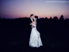 Bride & Groom kiss in the sunset