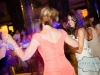 Bride dancing with mother in law and guests at a Carnegie Music Hall Pittsburgh wedding reception.