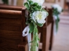 Flowers decorate the pew at Holy Cross Church wedding in Pittsburgh.