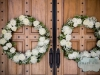 Wreaths on door of church Guests dancing at a Holy Cross Church wedding in Pittsburgh.