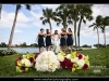 Bride and bridesmaids with bouquets of roses and peonies at the PGA Resort, Palm Beach Gardens.