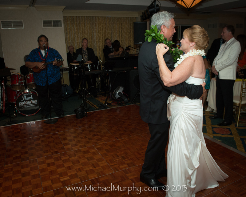 Couple shares first dance to John Parker Band.