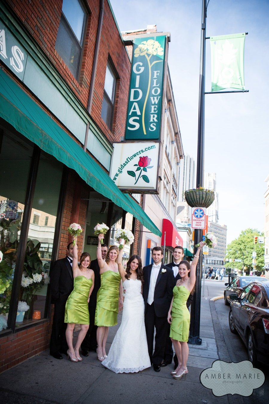 Bride and groom and wedding party at Gidas Flowers, the family business, in Pittsburgh.