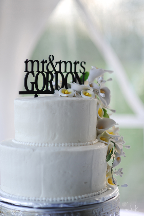 The Links Bloomsburg Wedding White Wedding Cake with Flowers and Name Topper