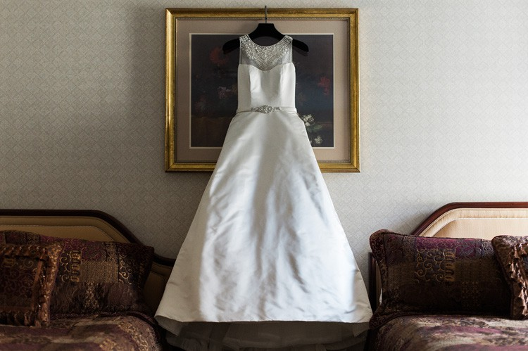 Omni William Penn Wedding White Gown with Neck Beading Hanging Up