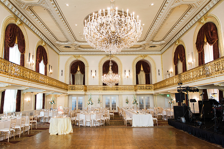 Omni William Penn Wedding Reception in Ballroom with Arched Windows and Chandelier