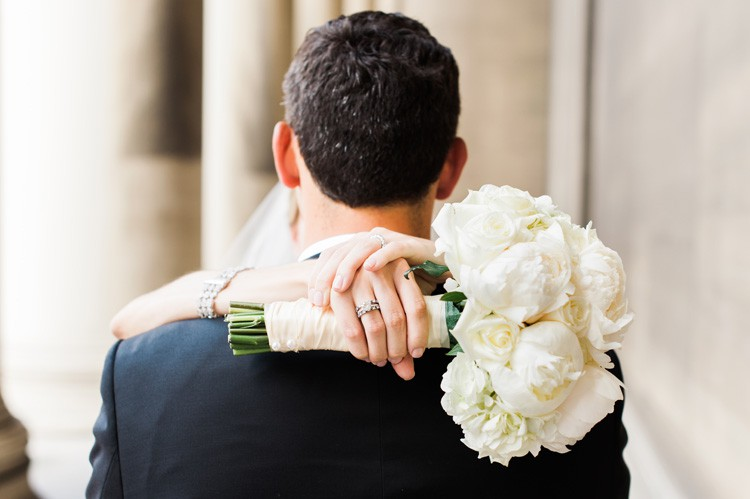 Omni William Penn Wedding Newlyweds with White Rose and Peony Bouquet and Wedding Ring