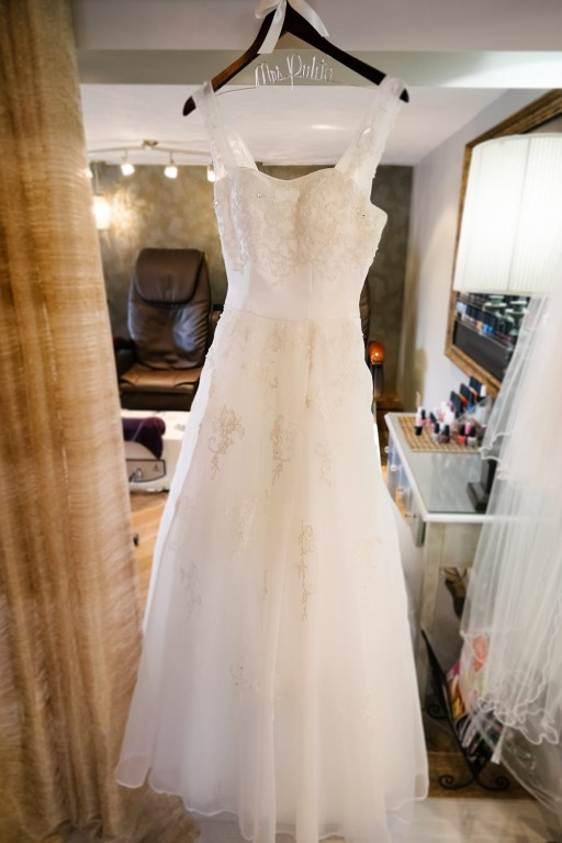 Circuit Center Ballroom Wedding - Wedding Dress Hangs Up in Spa