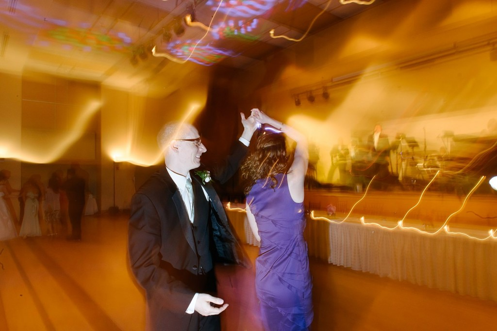 Circuit Center Ballroom Wedding Reception - Couple Twirls to John Parker Band