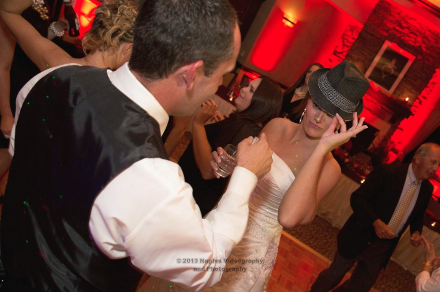 Golf Lodge at the Quarry Naples Wedding Reception - Bride Sports Groom's Fedora