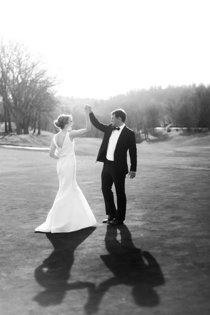 Longue Vue Club Wedding: Groom Twirls Bride on Golf Course