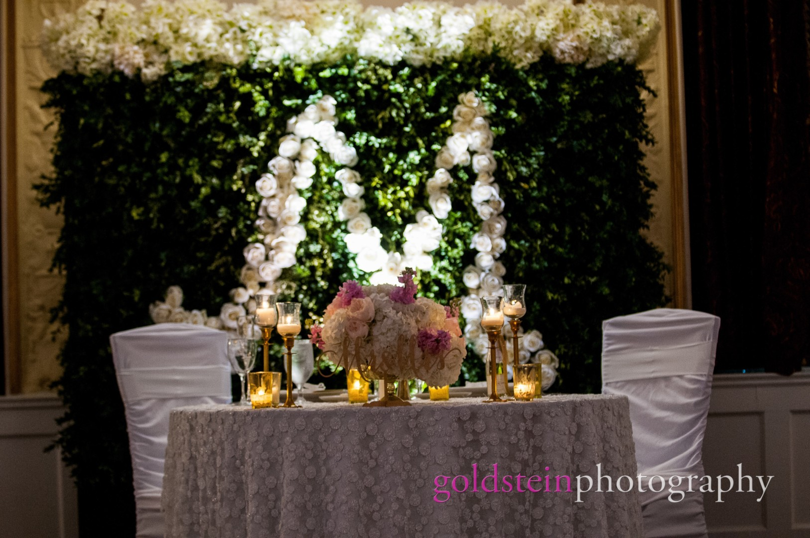 Bride Groom Sweetheart Table with Floral Monogram of Leaves & White Flowers at their wedding