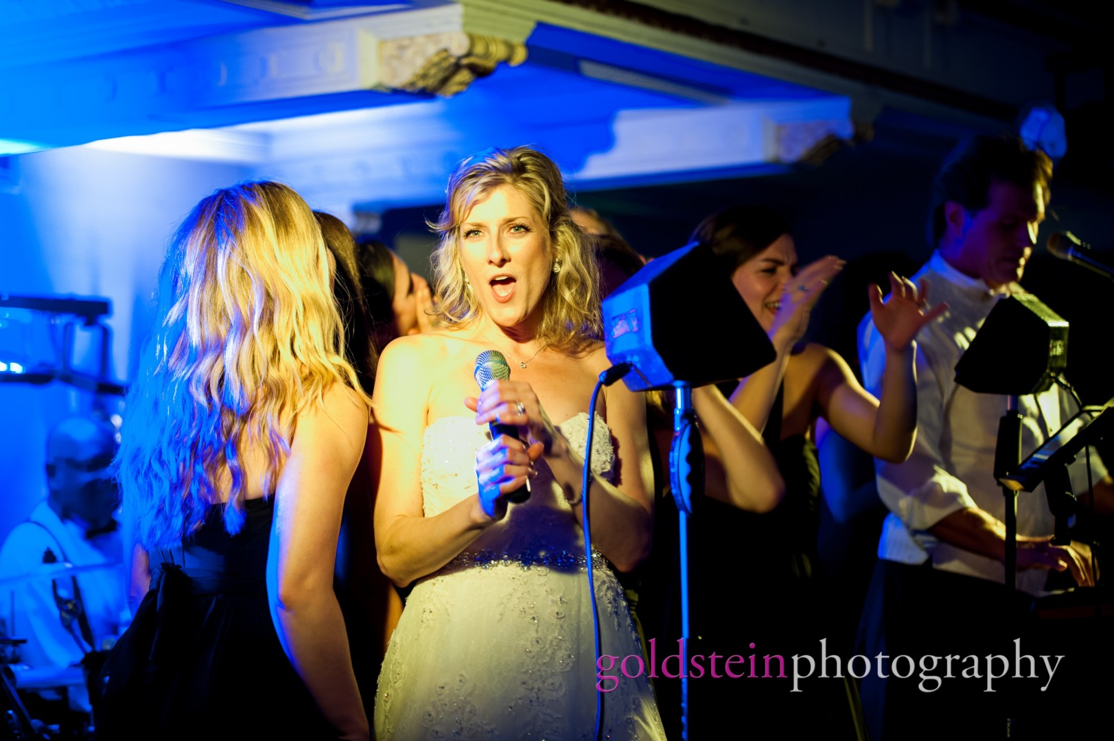 a bride sings with the John Parker Band at her wedding